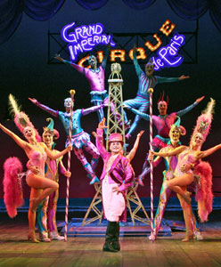 Michael Arnold (center) and company