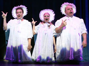 Christopher Fitzgerald, Kristin Chenoweth, and Kevin Chamberlin in Stairway to Paradise (© Joan Marcus)