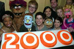 The cast of Avenue Q celebrates its 2000th performance.