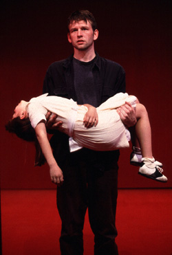 Dallas Roberts holding Nicole Pasquale in Nocturne(Photo: Joan Marcus)