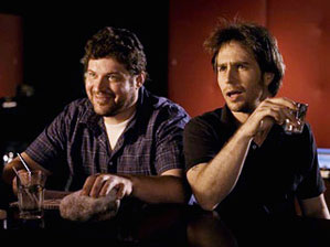 Brad Henke and Sam Rockwell in Choke