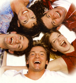The cast of I Sing!, clockwise from bottom:Jeff Juday, Michael Raine, Jodie Langel,Bill Eichner, and Meredith Zeitlin