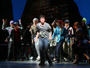 Graham Phillips (center) and company in 13 the Musical