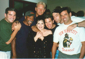 Liza Minnelli with some of theWorld Trade Center heroes at Shea Stadium(Photo: Jim Caruso)