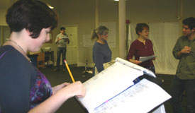 Director Caitlin Lowans with Aidan Kane, Lisa Foley, Dee Nelson, and Ben Sloane rehearsing Picnic (© Stoneham Theatre)