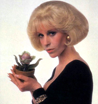 Ellen Greene with Audrey II inthe film version of Little Shop of Horrors