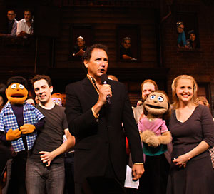 Kevin McCullum with Broadway cast members Rob McClure  and Anika Larsen and the rest of the Avenue Q family (© Tristan Fuge)