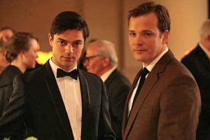 Dominic Cooper and Peter Sarsgaard in An Education