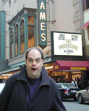 Still incredulous: Brad Oscar reacts to his billingon the marquee of the St. James