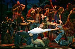 Gavin Creel (center) with the Tribe from Hair