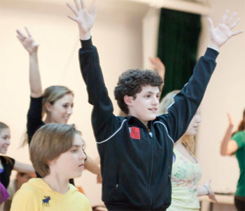Trent Kowalik teaching a dance from Billy Elliot the Musical