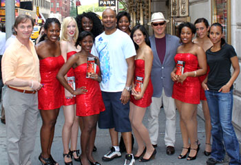 The cast of Race with red sequined dress ladies who promote the play (© Andy S. Drachenberg)
