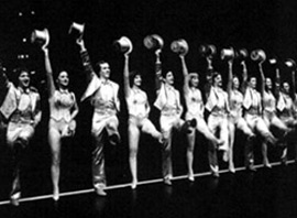 The cast of A Chorus Line waves goodbye to intermission