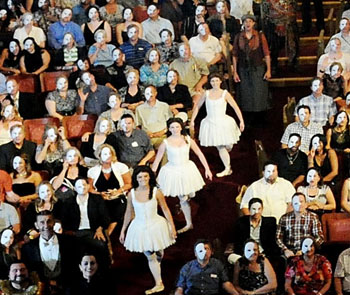 Cast members line the aisles amid mask-sporting theaterogers