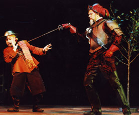 The barber (Jamie Torcellini) is confronted by Quixote(Photo: © Joan Marcus)