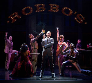 Eric Schneider (center) and company
