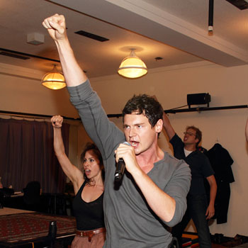 Benjamin Walker and the cast performing for the press