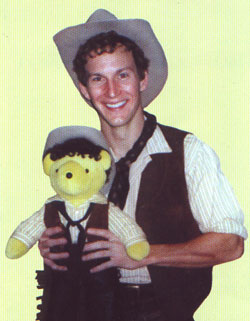 Patrick Wilson as Curly withhis Broadway Bear counterpart