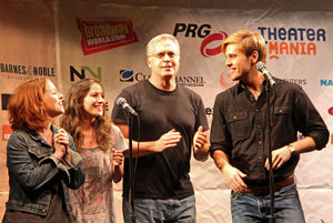Tom Hewitt (center) and cast members from