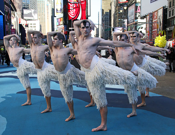Swan Lake cast members lead by Jonathan Ollivier (center)