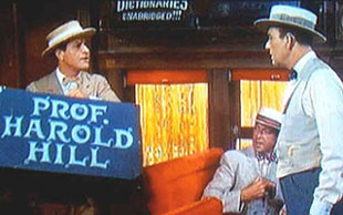 "In the original film, Harold Hill (Robert Preston) didn'treveal himself until the end of ""Rock Island"""