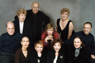 Grimes (center) and cast in a publicity photo for Wit & Wisdom