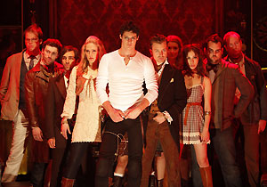 Benjamin Walker (center) and company