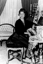Warfield at Liberace's pianoin the early 1970s.