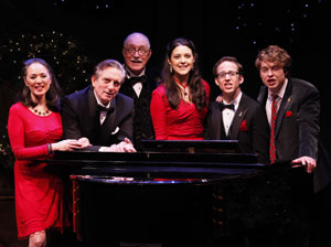 Victoria Mallory, Martin Vidnovic, Simon Jones, Kerry Conte, musical director John Bell, and Ashley Robinson in A Child's Christmas in Wales (© Carol Rosegg)