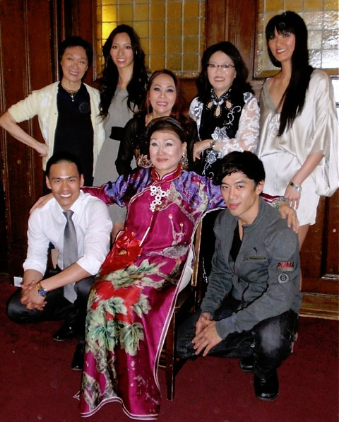 Pan Asian Rep artistic director Tisa Chang (top left) with the cast of We Are