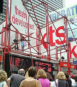 "Theatergoers check ""the board"" at TKTS to seewhat shows are offering half-price tickets"