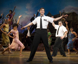 Nikki M. James, Andrew Rannells, Josh Gad and company in The Book of Mormon (© Joan Marcus)