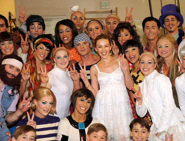 Kylie Minogue and the cast of LOVE
