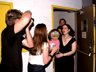 Price of fame:The stars of Avenue Q are accosted by fans  and paparazziat the stage door of the Golden