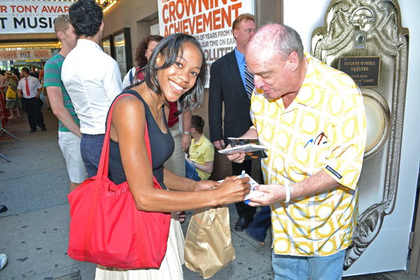 Nikki M. James signing autographs for a fan