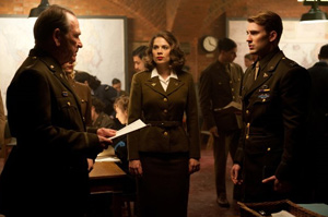 Tommy Lee Jones, Hayley Atwell, and Chris Evansin Captain America(© Jay Maidment/Marvel Studios)