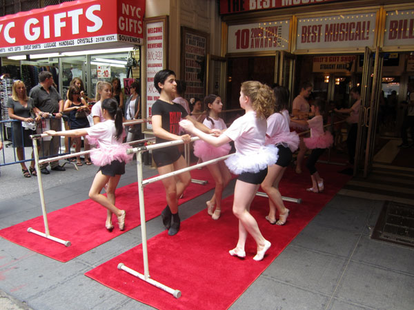 Giuseppe Bausilio with the Ballet Girls from Billy Elliot (© Lucas McMahon)