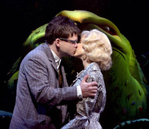 Hunter Foster, Kerry Butler, and Audrey IIin Little Shop of Horrors(Photo © Paul Kolnik)