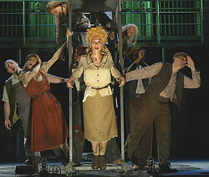 Carolee Carmello and the cast of Urinetown(Photo © Joan Marcus)