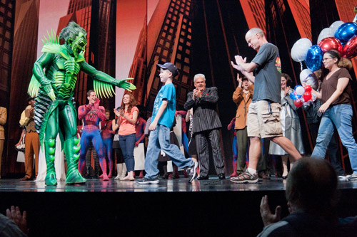 Patrick Page welcomes the Muir family onstage