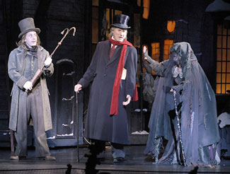 Justin Brill, Jim Dale, and Joan Barber inA Christmas Carol: The Musical(Photo © Richard Termine/Radio City Entertainment)