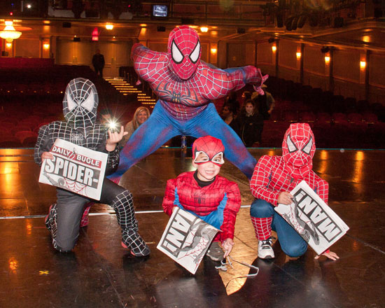 Christopher Tierney with kids in Spider-Man costumes