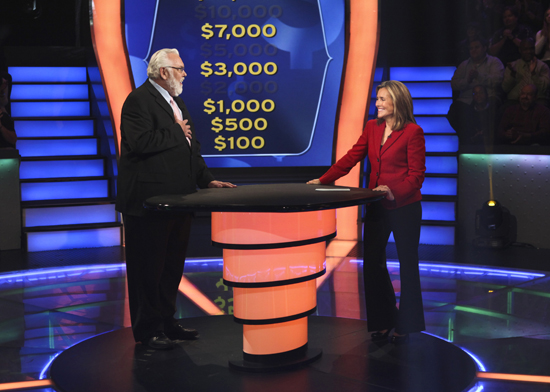 Jim Brochu with Meredith Veira on Who Wants to Be a Millionaire (Photo courtesy of Valleycrest Productions Ltd)