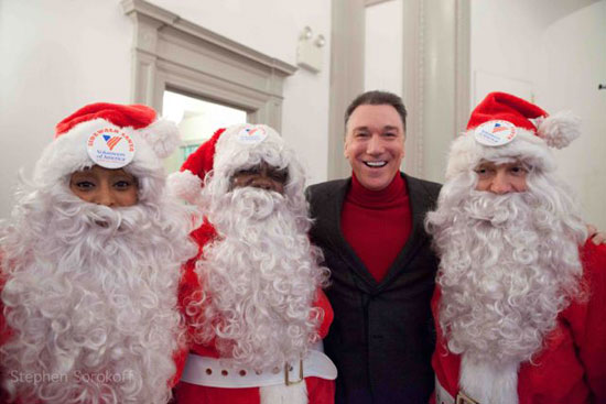 Patrick Page with volunteer santas
