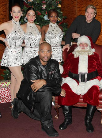 "Darryl ""DMC"" McDaniels and Matthew Modine with Santa and Rockettes