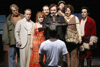 Alexander Gemignani, Jeffrey Kuhn, Mary Catherine Garrison,Denis O'Hare, Michael Cerveris, James Barbour,Becky Ann Baker, and Mario Cantone with(foreground:) Neil Patrick Harris in Assassins(Photo © Joan Marcus)