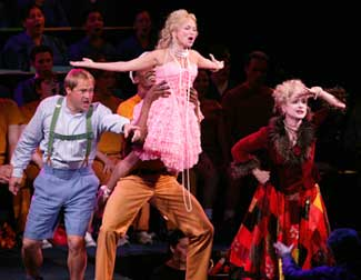 Paul Groves, Kristin Chenoweth (held aloft by Michael McElroy)and Patti LuPone in Candide(Photo © Chris Lee)