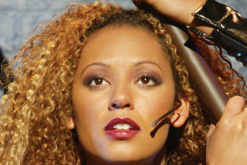 Melanie Brown and her face mic in Rent(Photo © Joan Marcus)