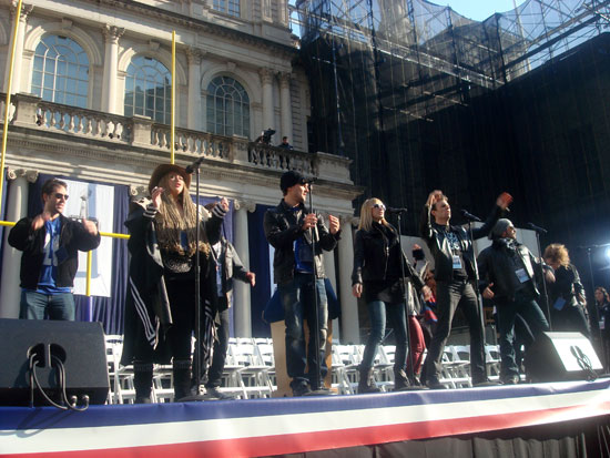 The cast of Rock of Ages performing in front of City Hall