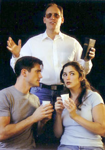 J. Mark McVey (standing),Matt Cavenaugh, and Marla Schaffel inJonestown: The Musical(Photo © Gabe Evans)